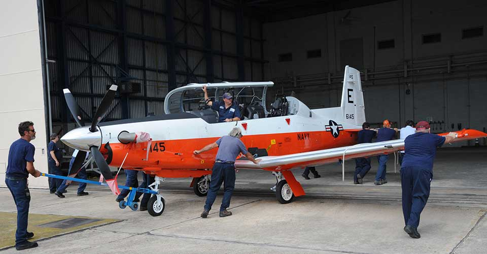 The final T-6B Texan II is maneuvered into place