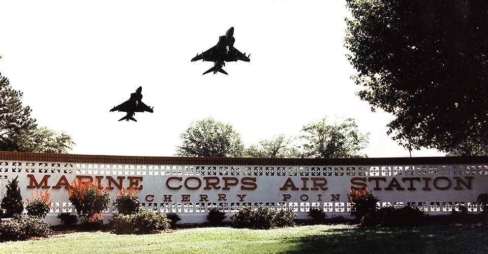 Harriers over the MCAS Cherry Point sign